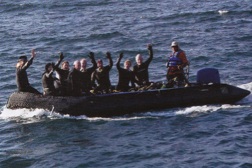 Photo of Happy Galapagos Glampers in a Rigid Inflatable Boat!