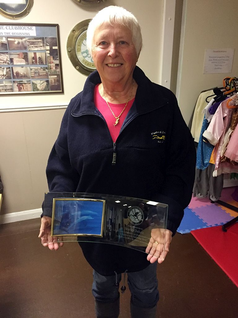 Shirley holding her trophy for long membership and commitment to the club